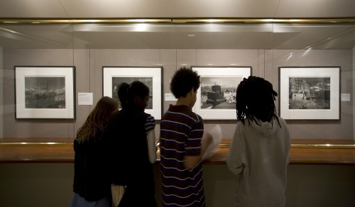 Students viewing photographs of Tibet by Kenro Izu in the exhibition Sacred Places, 2008, photograph by Eric Wheeler for the DIA
