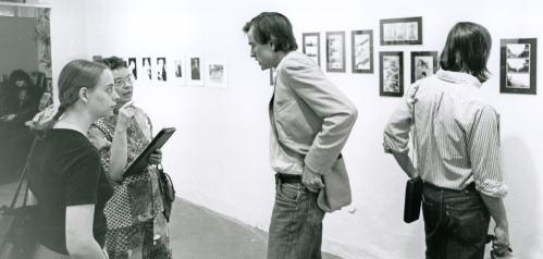 Joy Hakanson Colby interviewing Sam Wagstaff with Mapplethorpe at left in the background, Willis Gallery, Detroit, 1974. Photo: Brad Iverson